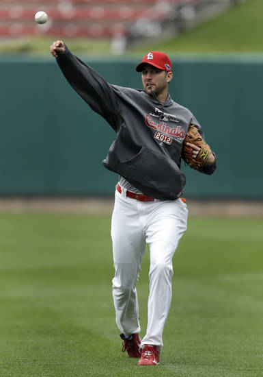 St. Louis Cardinals pitcher Adam Wainwright throws in the outfield during baseball practice, Saturday, Oct. 6, 2012, in St. Louis. Wainwright is scheduled to start in Game 1 of the National League division series against the Washington Nationals on Sunday. (AP Photo/Jeff Roberson)