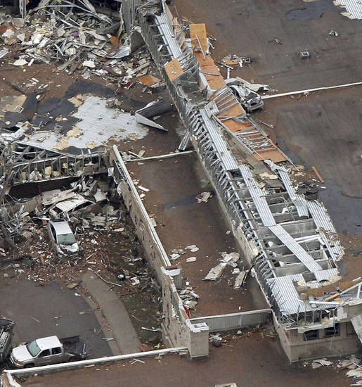 A car sits on the roof of the Moore Medical Center after it was destroyed by the May 20th tornado in Moore, OK, Tuesday, May 21, 2013,  By Paul Hellstern, The Oklahoman