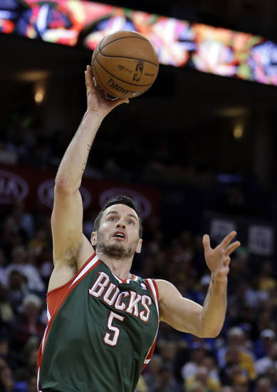 Milwaukee Bucks' J.J. Redick shoots against the Golden State Warriors during the first half of an NBA basketball game Saturday, March 9, 2013, in Oakland, Calif. (AP Photo/Ben Margot)