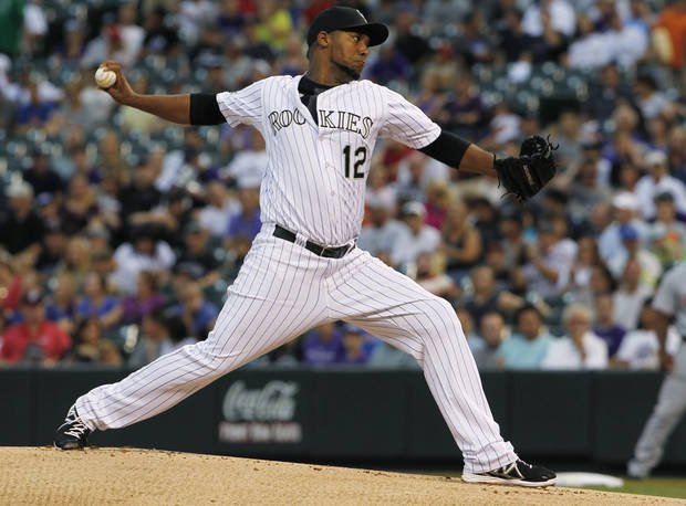 Colorado Rockies starting pitcher Juan Nicasio work against the Cincinnati Reds in the first inning of a baseball game in Denver on Saturday, Aug. 31, 2013. (AP Photo/David Zalubowski)