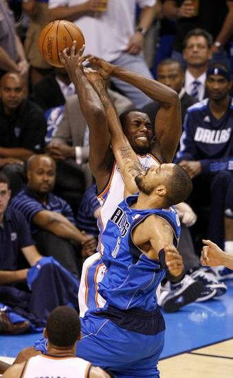 Oklahoma City's Serge Ibaka (9) reaches for the ball behind Tyson Chandler (6) of Dallas during game 4 of the Western Conference Finals in the NBA basketball playoffs between the Dallas Mavericks and the Oklahoma City Thunder at the Oklahoma City Arena in downtown Oklahoma City, Monday, May 23, 2011. Photo by Bryan Terry, The Oklahoman ORG XMIT: KOD