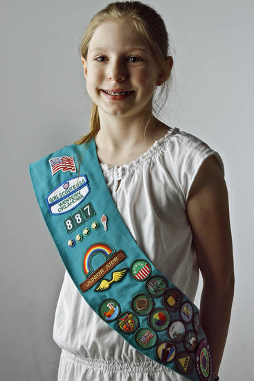 Girl Scout Jadyn Carter wears her sash  on Wednesday, Jan. 18, 2012, in Oklahoma City, Okla. Photo by Chris Landsberger, The Oklahoman