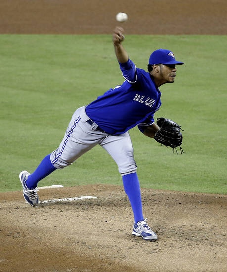 Toronto Blue Jays pitcher Esmil Rogers delivers a pitch against the Arizona Diamondbacks during the first inning of a baseball game,  Monday, Sept. 2, 2013, in Phoenix. (AP Photo/Matt York)