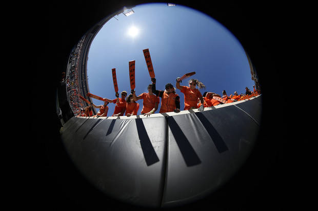 Paddle People cheer before a college football game between Oklahoma State University (OSU) and Texas Christian University (TCU) at Boone Pickens Stadium in Stillwater, Okla., Saturday, Oct. 27, 2012. Photo by Sarah Phipps, The Oklahoman
