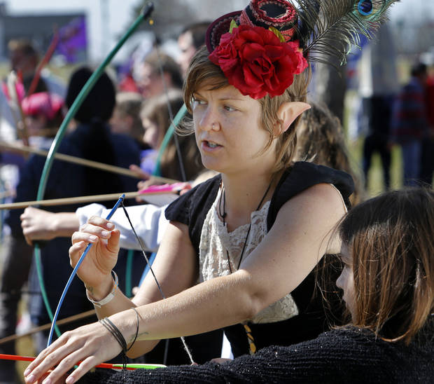 Elfan archery instructor Brandi Adair, of Gainsville, Fla., helps Eden Rodriguez with her bow during the Medieval Fair in Norman.  Photo by Steve Sisney, The Oklahoman <strong>STEVE SISNEY</strong>