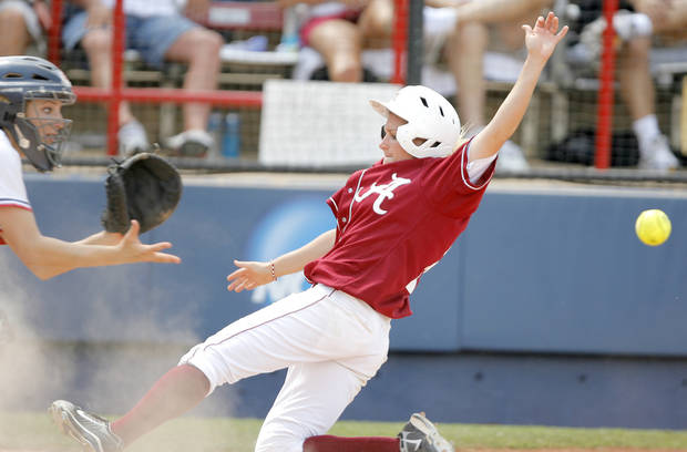 Alabama's Danie Woods is unable to beat the throw at home as Arizona's Callista Balko  forces her out in the fourth inning of the Women's College World Series game between Alabama and Arizona at ASA Hall of Fame Stadium in Oklahoma City, Saturday, May 31, 2008.  BY BRYAN TERRY, THE OKLAHOMAN