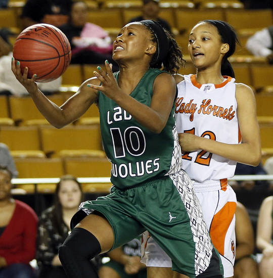 Edmond Santa Fe's Cameerah Graves (10) takes a shot in front of Booker T. Washington's Kaylan Mayberry (12) during a Class 6A girls high school basketball game in the semifinals of the state tournament at the Mabee Center in Tulsa, Okla., Friday, March 8, 2013. Bookter T. Washington won, 72-70. Photo by Nate Billings, The Oklahoman