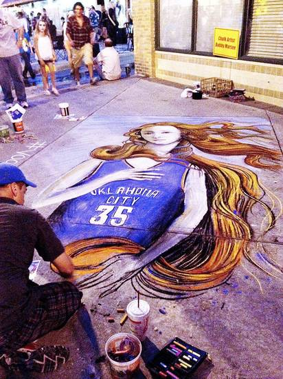 An artist draws Botticelli�s Venus wearing Kevin Durant�s Thunder jersey in chalk on the sidewalk Friday at Live on the Plaza in Oklahoma City. Photo by Michael Kimball, The Oklahoman