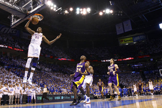 Oklahoma City's Kevin Durant dunks the ball in front of Los Angeles' Kobe Bryant on a fast break during Game 2 in the second round of the NBA playoffs between the Oklahoma City Thunder and the L.A. Lakers at Chesapeake Energy Arena on Wednesday,  May 16, 2012, in Oklahoma City, Oklahoma. Photo by Chris Landsberger, The Oklahoman
