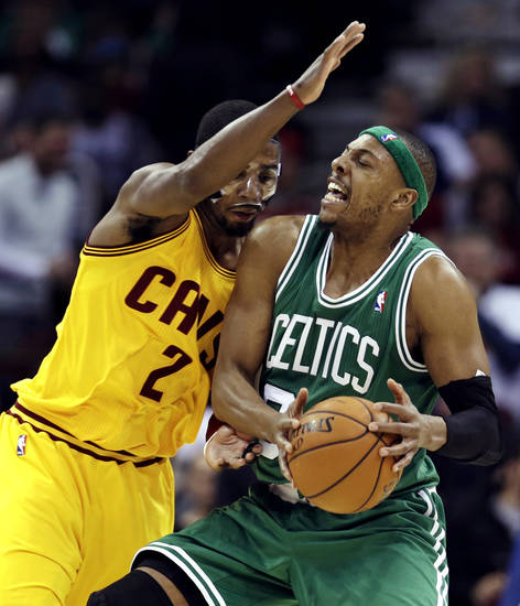 Boston Celtics' Paul Pierce, right, is stopped by Cleveland Cavaliers' Kyrie Irving during the second quarter of an NBA basketball game, Tuesday, Jan. 22, 2013, in Cleveland. (AP Photo/Tony Dejak)