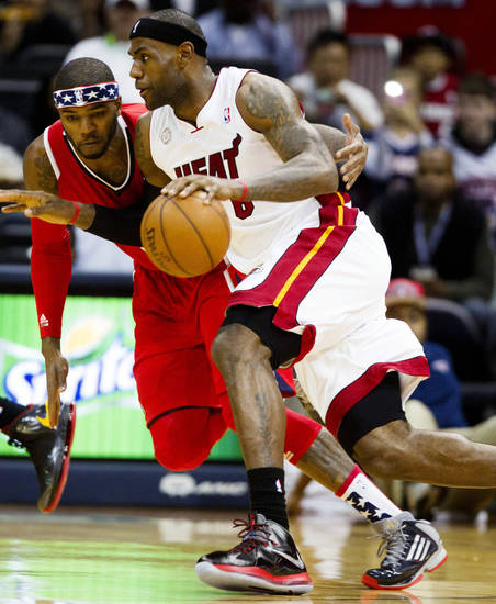 Miami Heat forward LeBron James (6) drives against Atlanta Hawks forward Josh Smith (5) in the first half of an NBA basketball game in Atlanta, Friday, Nov. 9, 2012. (AP Photo/John Bazemore)