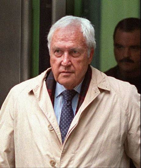 "** FILE ** Former Boston FBI agent H. (Herald) Paul Rico leaves Federal Court in Boston in this Jan. 13, 1998 file photo, after being questioned about his relationship with reputed mobsters James ""Whitey"" Bulger and Stephen J. Flemmi.  Rico was arrested Thursday, Oct. 9, 2003, in Miami, Fla., and charged with murder in connection with the 1981 mob-related killing of Tulsa, Okla., businessman Roger Wheeler.(AP Photo/The Boston Globe,John Tlumacki, File)"