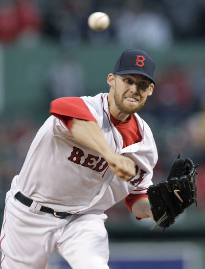 Boston Red Sox starting pitcher Daniel Bard throws to an Oakland Athletics batter during the first inning of a baseball game at Fenway Park in Boston, Wednesday, May 2, 2012. (AP Photo/Elise Amendola)