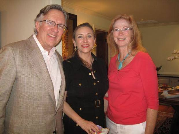 Tom and Lisa Price and Jane Crain talk at a recent opne house. Jane and John Crain invited friends to see the re-model of their home in Nichols Hills. It was a come- and- go event and guests enjoyed cocktails and hors d�oeuvres during their tour of the beautiful home. (Photo by Helen Ford Wallace).