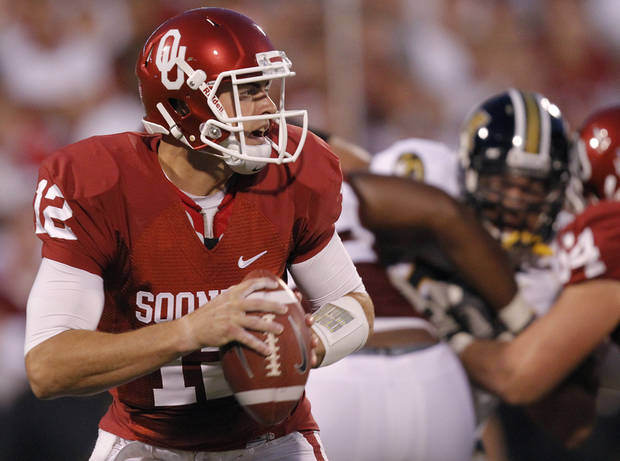 Oklahoma's Landry Jones (12) looks to pass during the Sooners' game with Missouri on Saturday in Norman. Photo by Chris Landsberger, The Oklahoman