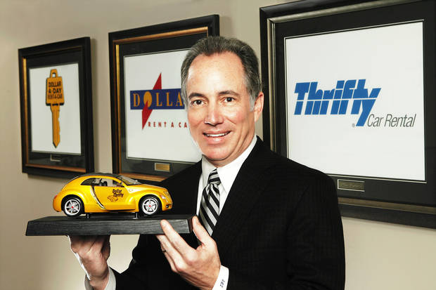 Scott Thompson, CEO of Dollar Thrify Automotive Group, Inc, in the company's Tulsa headquarters office Tuesday. PHOTO BY JIM Beckel, The Oklahoman
