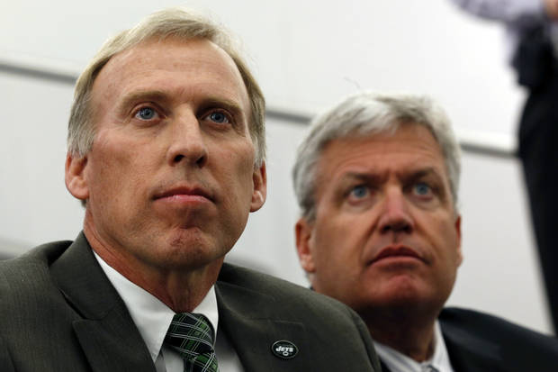 John Idzik, left, sits next to New York Jets head coach Rex Ryan while waiting to be introduced as the Jets new general manager during an NFL football news conference, Thursday, Jan. 24, 2013, in Florham Park , N.J. (AP Photo/Julio Cortez)