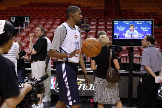 Oklahoma City's Kevin Durant dribbles past a TV with showing a press conference with coach Scott Brooks before a practice for Game 5 of the NBA Finals between the Oklahoma City Thunder and the Miami Heat at American Airlines Arena, Wednesday, June 20, 2012. Photo by Bryan Terry, The Oklahoman