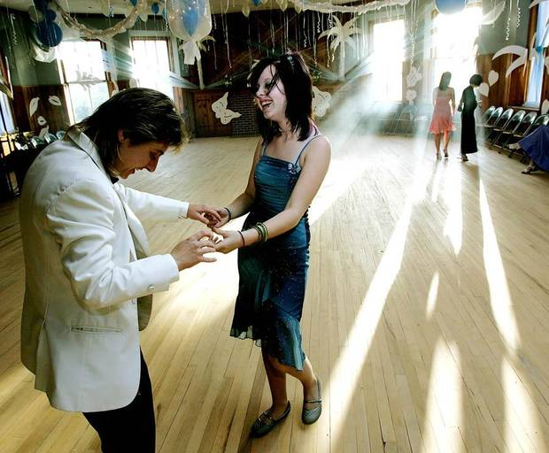 April Lott (left) dances with her daughter Cati Hill at the beginning of  the city's second annual Gay Prom at Epworth United Methodist Church in Oklahoma City on Thursday, May 11, 2006. By John Clanton, The Oklahoman