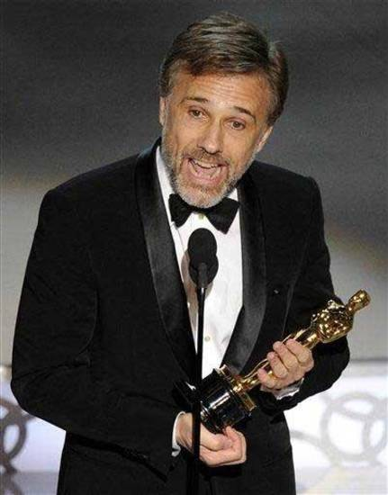"Christoph Waltz accepts the Oscar for best performance by an actor in a supporting role for ""Inglourious Basterds"" at the 82nd Academy Awards Sunday, March 7, 2010, in the Hollywood section of Los Angeles. AP Photo"