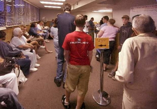 File photo of long lines waiting to take driver's license tests at the Edmond office by Paul Hellstern