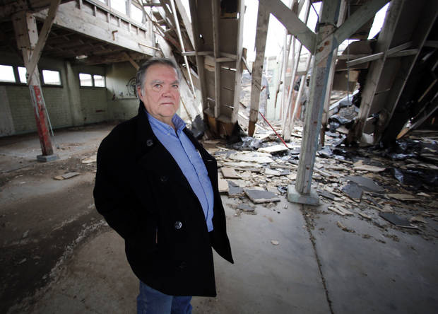 Above: Duane Manuel, a Burns Flat town councilman, looks at a dilapidated and abandoned Air Force base warehouse.