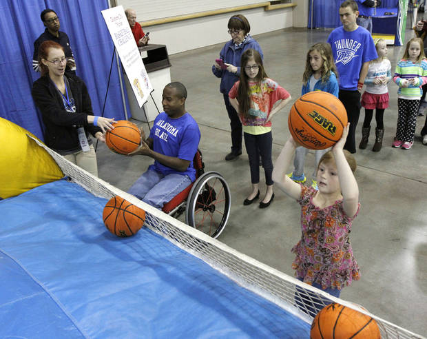 Participants try and shoot baskets during Bart & Nadia's Sports & Health Festival at the Cox Convention Center in Oklahoma City, OK, Saturday, February 16, 2013,  By Paul Hellstern, The Oklahoman