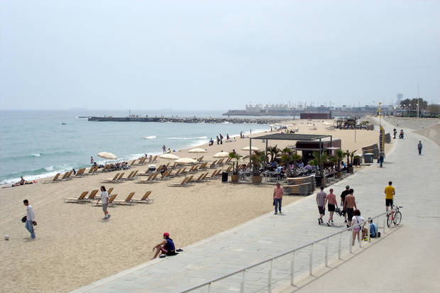 "Once an industrial wasteland, Barcelona's sandy coastline is now scattered with cute beachside bars called ""chiringuitos."" (Photo by Rick Steves)"