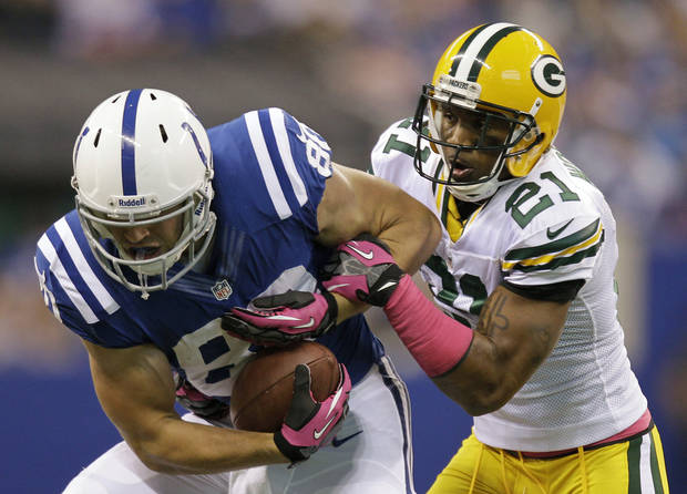 Indianapolis Colts tight end Coby Fleener (80) is tackled by Green Bay Packers strong safety Charles Woodson (21) during the first half of an NFL football game in Indianapolis, Sunday, Oct. 7, 2012. (AP Photo/Michael Conroy)