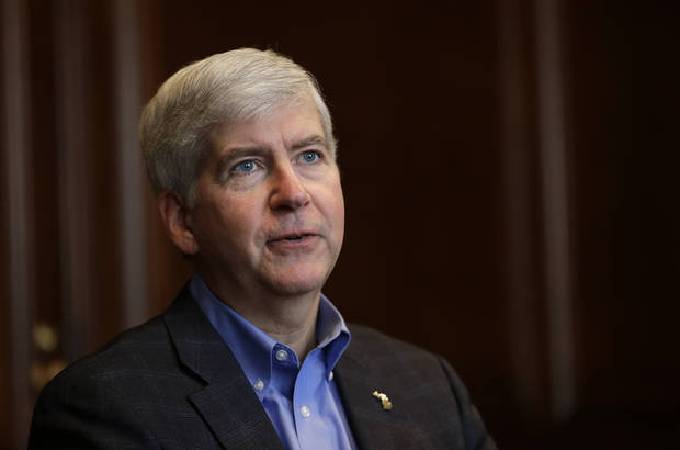 Gov. Rick Snyder tells the Associated Press he will declare a financial emergency prior his television broadcast in Detroit, Friday, March 1, 2013. Snyder declared a financial emergency in Detroit on Friday, pushing the city closer to having a state-appointed emergency manager control its finances. (AP Photo/Paul Sancya)