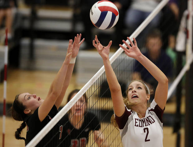 Edmond's Linsey roy (2) goes against Bishop Kelley's Liza Hepner (7) during the OSSAA 6A State Volleyball Championship between Bishop Kelley and Edmond Memorial at Westmoore High School in Moore, Okla., Saturday, Oct. 13, 2012.  Photo by Garett Fisbeck, The Oklahoman