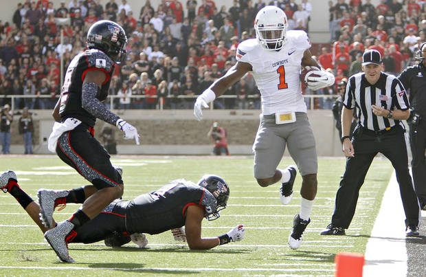 Oklahoma State Cowboys running back Joseph Randle (1) is run out of bounds by Texas Tech Red Raiders safety Terrance Bullitt (1) and D.J. Johnson (12)during the college football game between the Oklahoma State University Cowboys (OSU) and Texas Tech University Red Raiders (TTU) at Jones AT&T Stadium on Saturday, Nov. 12, 2011. in Lubbock, Texas.  Photo by Chris Landsberger, The Oklahoman