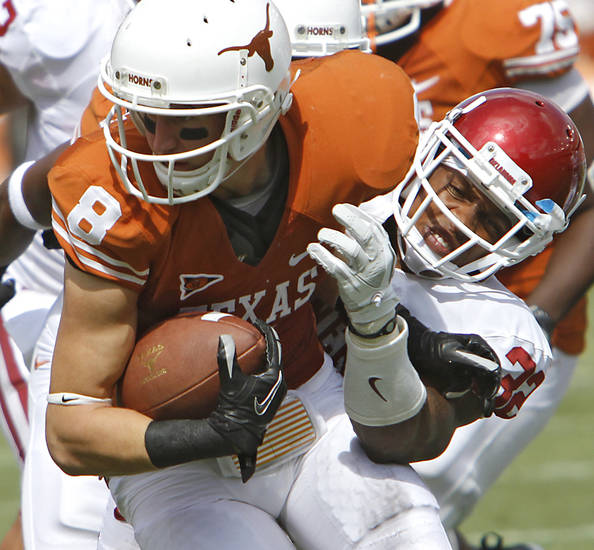 Oklahoma's Jamell Fleming (32) brings down Texas' Jaxon Shipley (8) during the Red River Rivalry college football game between the University of Oklahoma Sooners (OU) and the University of Texas Longhorns (UT) at the Cotton Bowl in Dallas, Saturday, Oct. 8, 2011. Photo by Chris Landsberger, The Oklahoman