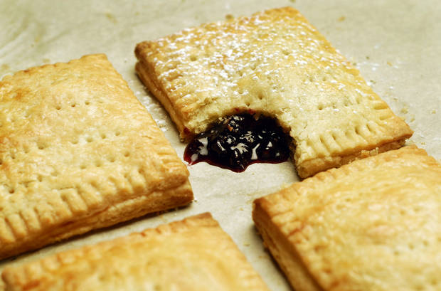 Put a homemade spin on pop-tarts while satisfying our grown-up palates. Here, berry jam pop-tarts. (Mark DuFrene/Contra Costa Times/MCT)