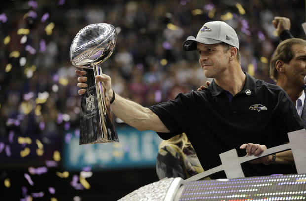 Baltimore Ravens head coach John Harbaugh holds the Vince Lombardi Trophy as he celebrates his team's 34-31 win against the San Francisco 49ers in the NFL Super Bowl XLVII football game, Sunday, Feb. 3, 2013, in New Orleans. (AP Photo/Matt Slocum)
