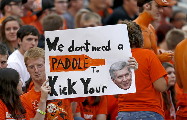 OSU sophomore Mark Denker from Garland, Texas, holds a sign prior to a college football game between Oklahoma State University (OSU) and the University of Texas (UT) at Boone Pickens Stadium in Stillwater, Okla., Saturday, Sept. 29, 2012. Photo by Bryan Terry, The Oklahoman