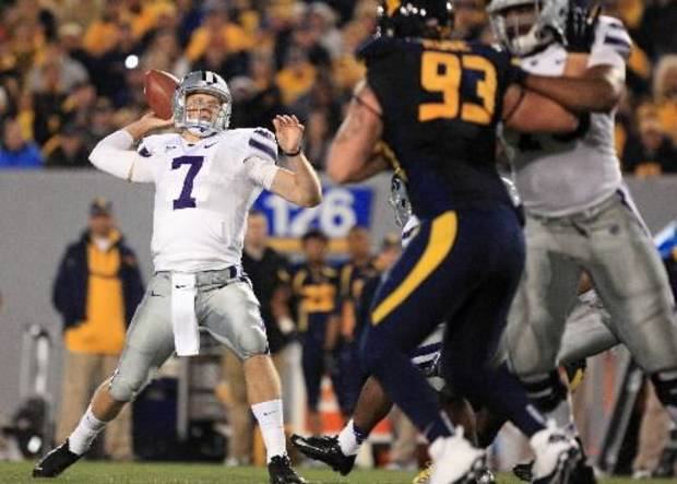 Kansas State quarterback Collin Klein ( 7) prepares to pass during an NCAA college football game against West Virginia in Morgantown, W. Va., Saturday, Oct. 20, 2012. Kansas State won 55-14. (AP Photo/Christopher Jackson)