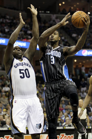 Orlando Magic's Earl Clark (3) goes to the basket over Memphis Grizzlies' Zach Randolph during the first half of an NBA basketball game in Memphis, Tenn., Thursday, April 26, 2012. (AP Photo/Danny Johnston)