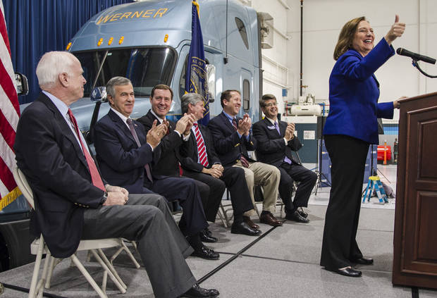 Republican Senate candidate Deb Fischer gives the thumbs up sign as from left: Sen. John McCain, R-Ariz., Sen. Mike Johanns, R-Neb., Lt. Gov. Rick Sheehy, Rep. Jeff Fortenberry, R-Neb., Rep. Adrian Smith, R-Neb., and Rep. Lee Terry, R-Neb., lend their support at a rally in Omaha, Neb., Friday, Nov. 2, 2012. Fischer is running against Democrat Bob Kerrey for the Senate seat of retiring Ben Nelson, D-Neb. (AP Photo/Nati Harnik)