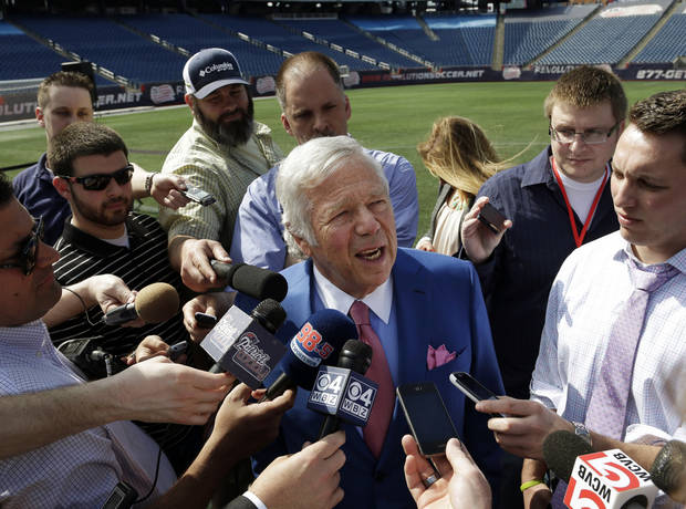 New England Patriots owner Robert Kraft, center, speaks with reporters on the NFL football field at Gillette Stadium in Foxborough, Mass., Thursday, May 2, 2013. (AP Photo/Steven Senne)