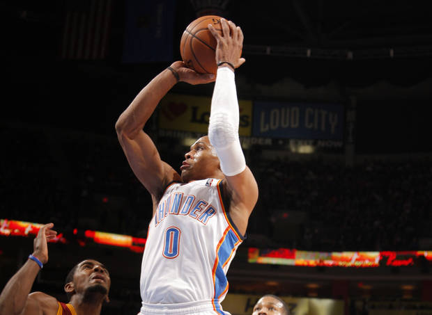 Oklahoma City&#039;s Russell Westbrook (0) shoots in between Cleveland&#039;s Kyrie Irving and Alonzo Gee (33) during the NBA basketball game between the Oklahoma City Thunder and the Cleveland Cavaliers at the Chesapeake Energy Arena, Sunday, Nov. 11, 2012. Photo by Sarah Phipps, The Oklahoman