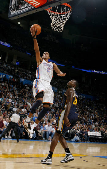 Oklahoma City's Thabo Sefolosha shoots a lay up in front of Utah's Paul Millsap during the NBA basketball game between the Oklahoma City Thunder and Utah Jazz in the Oklahoma City Arena on Sunday, Oct. 31, 2010. Photo by Sarah Phipps, The Oklahoman