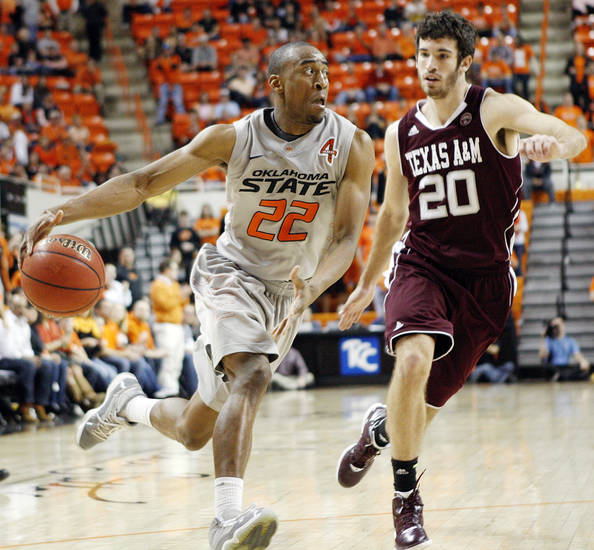 OSU's Markel Brown (22) drives to the basket as Texas A&M's Daniel Alexander defends during a men's college basketball game between the Oklahoma State University Cowboys and Texas A&M University Aggies at Gallagher-Iba Arena in Stillwater, Okla., Saturday, Feb. 25, 2012. OSU won, 60-42. Photo by Nate Billings, The Oklahoman