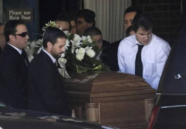 Corey Haim's casket is being placed into a hearse during his funeral in Toronto. (AP photo by Chris Young)