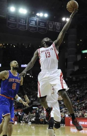Houston Rockets' James Harden (13) goes to the basket in front of New York Knicks' Tyson Chandler (6) in the second half of an NBA basketball game on Friday, Nov. 23, 2012, in Houston. (AP file)