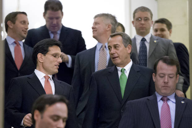 "Speaker of the House John Boehner, R-Ohio, center right, and House Majority Leader Eric Cantor, R-Va., center left, walk down stairs to a second Republican conference meeting to discuss the ""fiscal cliff"" bill_ which was passed by the Senate Monday night_ at the Capitol in Washington, Tuesday, Jan. 1, 2013.  (AP Photo/J. Scott Applewhite)"