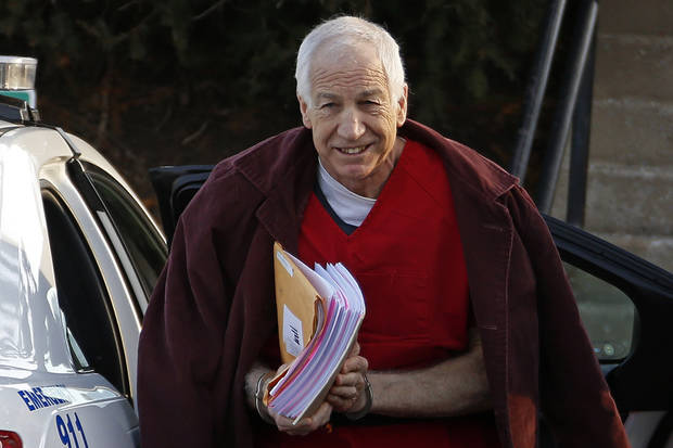 Former Penn State University assistant football coach Jerry Sandusky arrives at the Centre County Courthouse for a post-sentence motion in Bellefonte, Pa., Thursday, Jan. 10, 2013. (AP Photo/Gene J. Puskar)