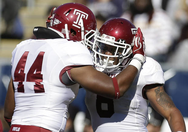 Temple running back Montel Harris (8) celebrates his touchdown with teammate Wyatt Benson (44) in the first quarter of an NCAA college football game in East Hartford, Conn., Saturday, Oct. 13, 2012. (AP Photo/Michael Dwyer)