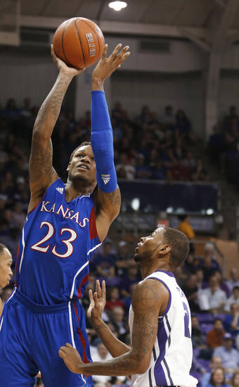 Kansas guard Ben McLemore (23) shoots over TCU forward Connell Crossland (2) during the first half of an NCAA college basketball game Wednesday, Feb. 6, 2013, in Fort Worth, Texas. (AP Photo/Sharon Ellman)