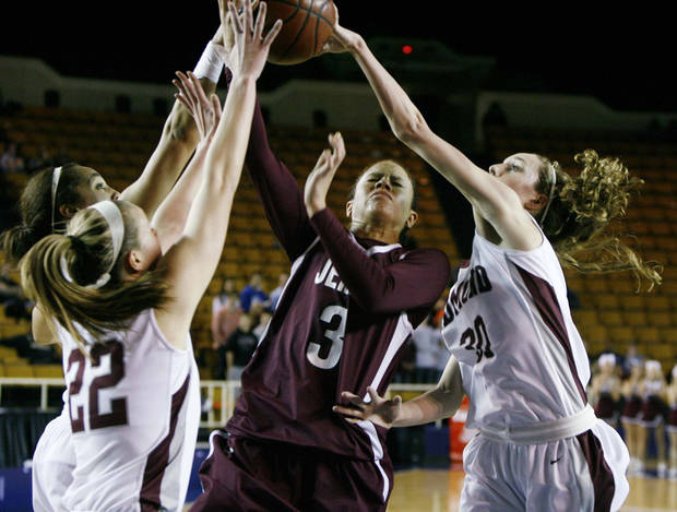 CLASS 6A GIRLS HIGH SCHOOL BASKETBALL / STATE TOURNAMENT: Jenks Lady Trojans No. 3 Jessica Washington gets caught between Edmond Memorial Lady Bulldogs No. 22 Alie Decker and No. 30 Jenny Roy during the girls 6A State quarterfinal basketball game at the ORU Mabee Center in Tulsa, Okla., taken on March 8, 2012. JAMES GIBBARD/Tulsa World